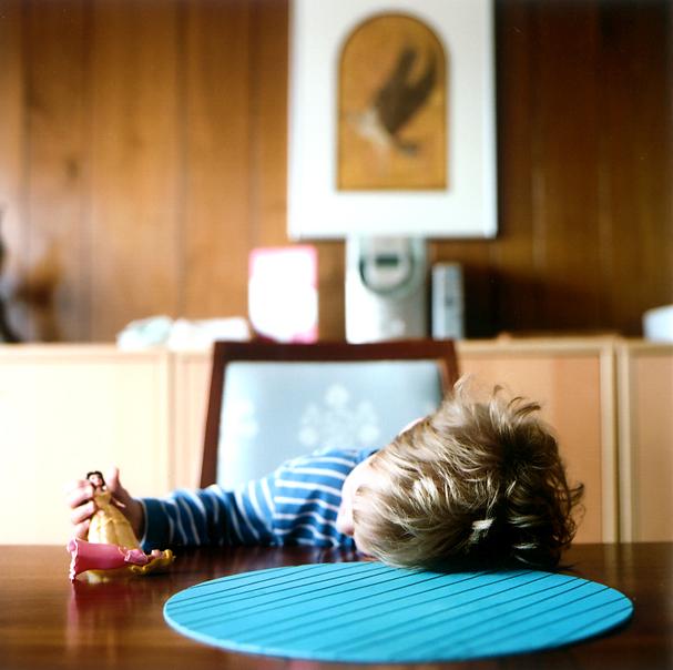 Boy with dolls (2009) © Sheila Newbery