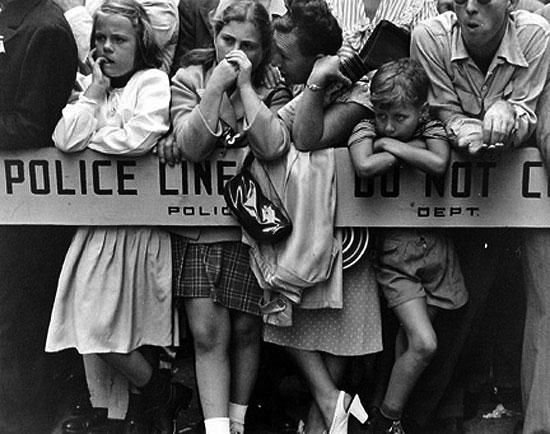 Legion Parade    (c. 1940)   by Ruth Orkin